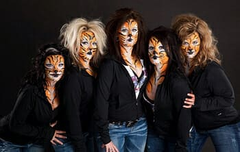 The CR Spirits made up as tigers for a video shoot
